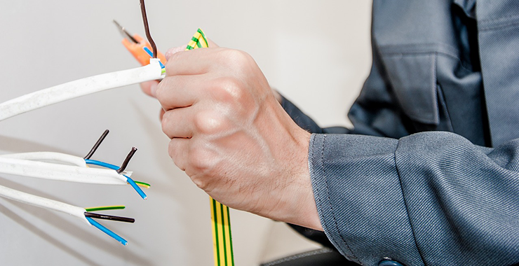 Electrician cutting wire